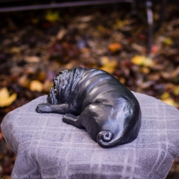 napping pug statue in fawn and black (5 of 16)